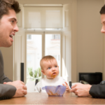 Couple arguing in front of concerned baby.