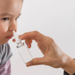 child getting vaccine via nasal spray