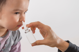 child getting vaccine via nasal spray