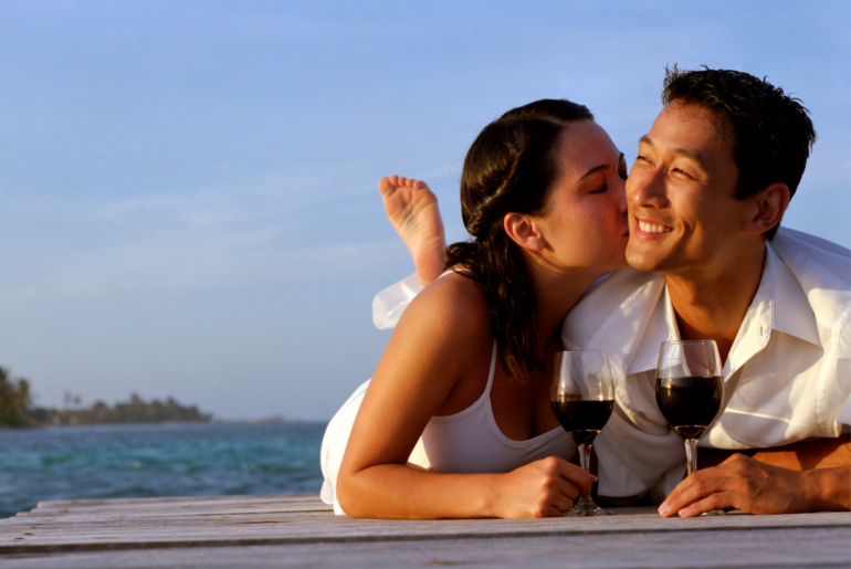 couple drinking wine on a dock