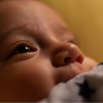 Close up of a baby that is wide awake.