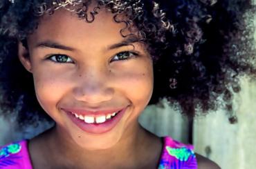 Girl smiles at the camera.