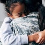 Child hugging her mother.