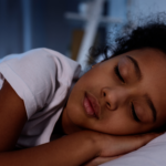 Girl asleep in her bed.