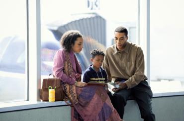 Family waiting at airport.