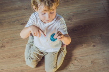Boy playing with fidget spinner.
