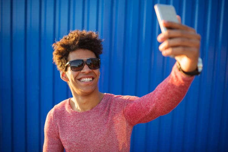 Teen takes selfie.