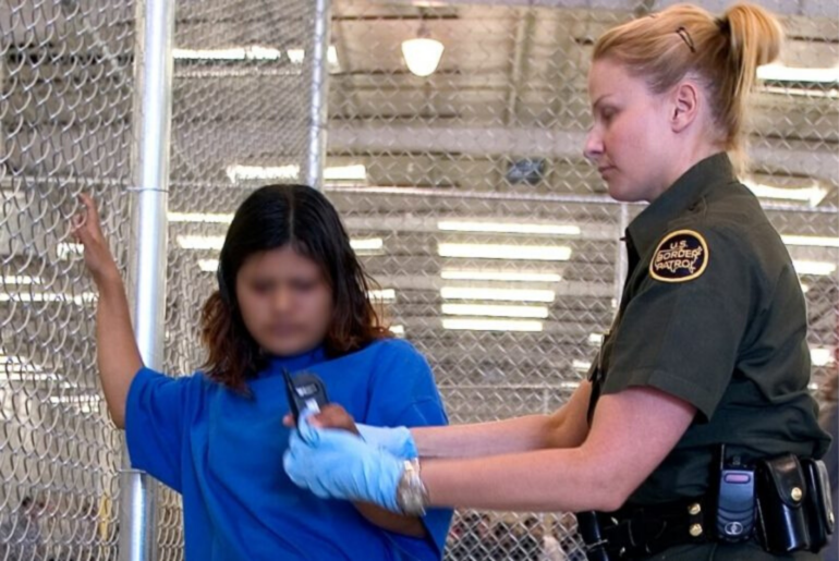 CBP agent conducts a pat down of a child.