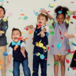 Children celebrating with confetti.