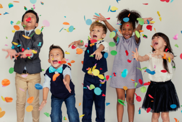 Children celebrating with confetti.