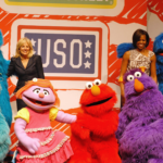 Sesame Street characters pose with Jill Biden and Michelle Obama.