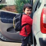 Child getting into an SUV.