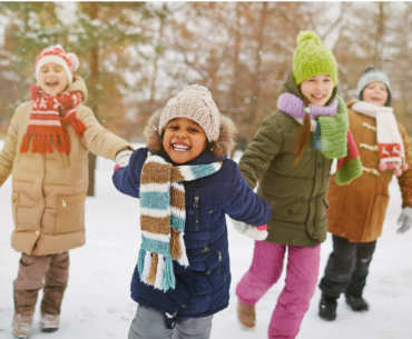 Kids playing outdoors in the winter.
