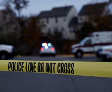 Police line tape at crime scene.