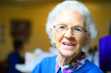 Elderly woman smiling.