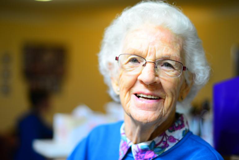 Elderly woman smiling.