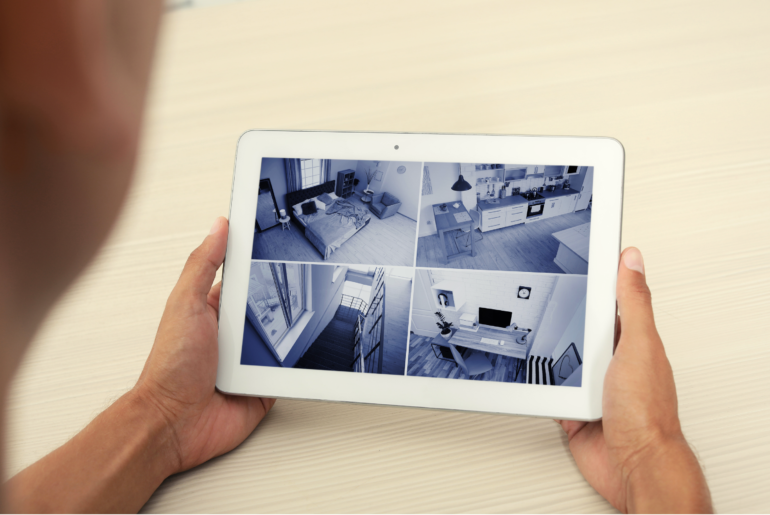Home security system cameras displayed on an iPad.