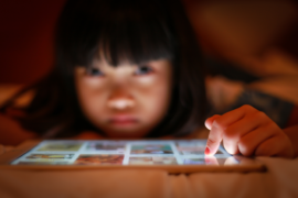 Young girl using tablet.