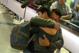 Migrant parent and child reunited.
