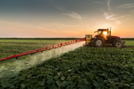 Pesticide being sprayed on a field.