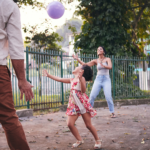 Family playing outdoors.