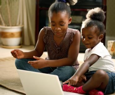 Girls looking at laptop