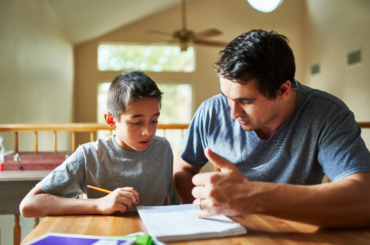 Father and son working on school assignment.