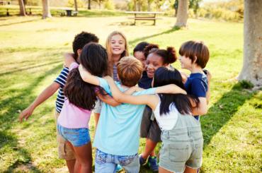 Kids huddling at summer camp.