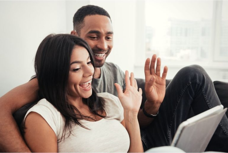 Couple socializing on a video chat.