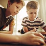 Two boys using a tablet.
