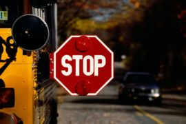 School bus with stop sign extended.
