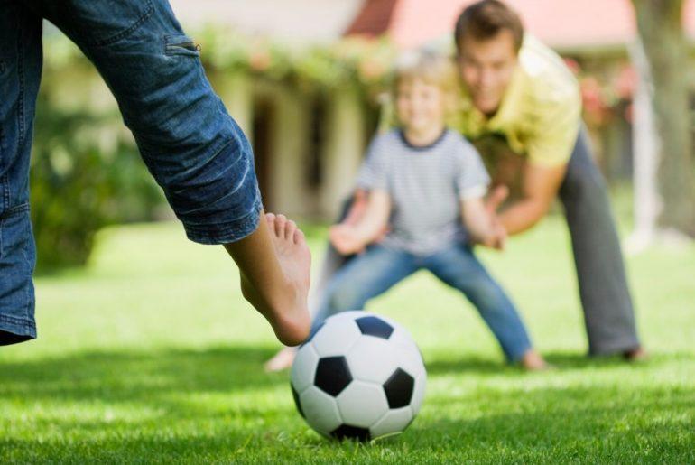 Children kicking a ball.