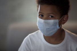Boy wearing face mask.