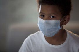 Boy wearing face mask.