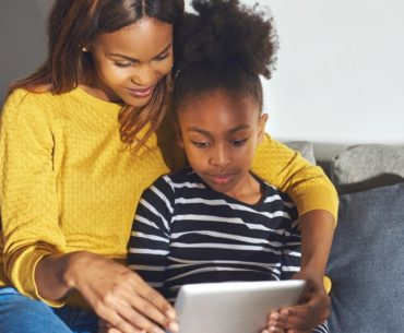 Mother and daughter using tablet together.
