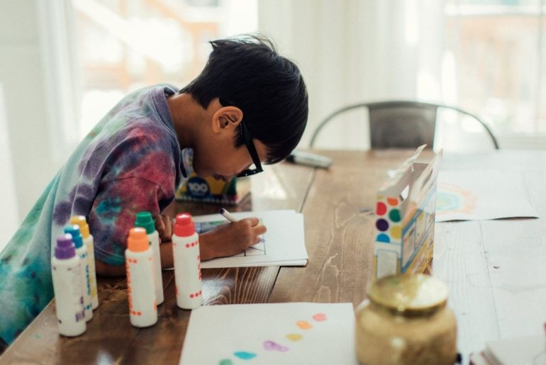 Boy engaged in a learning activity at home.