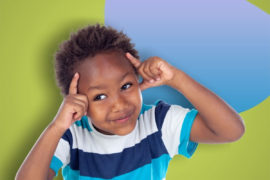 Boy doing a thinking gesture.