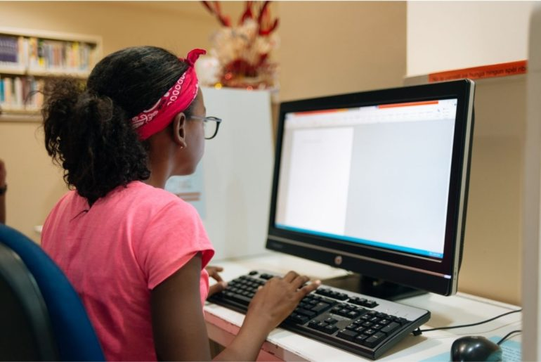 Student working at a computer at home.