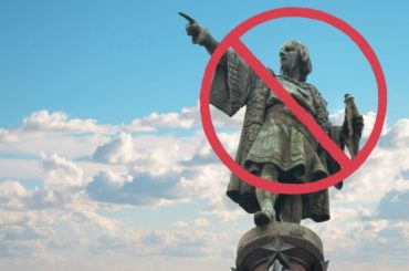 Christopher Columbus statue with a not allowed mark superimposed.