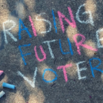"Chalk drawing that reads: ""Raising future voters"""