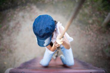 Child climbing rope.