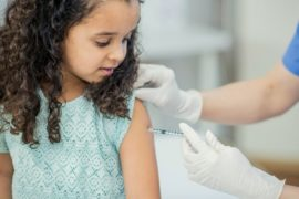 Girl getting vaccination.