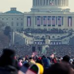 Photo of a crowd celebrating inauguration day in front of the U.S. capitol.