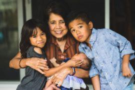 Grandmother holding three grandkids.