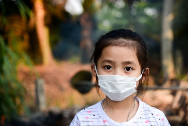 Young girl wearing face mask.