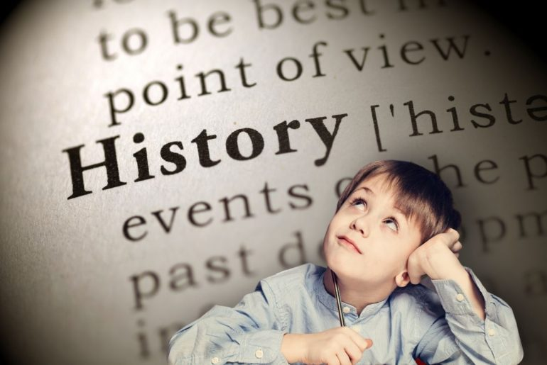 "Boy thinking over background of ""History"" dictionary listing."