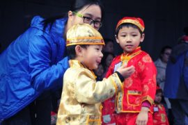 Children in lunar new year costumes.