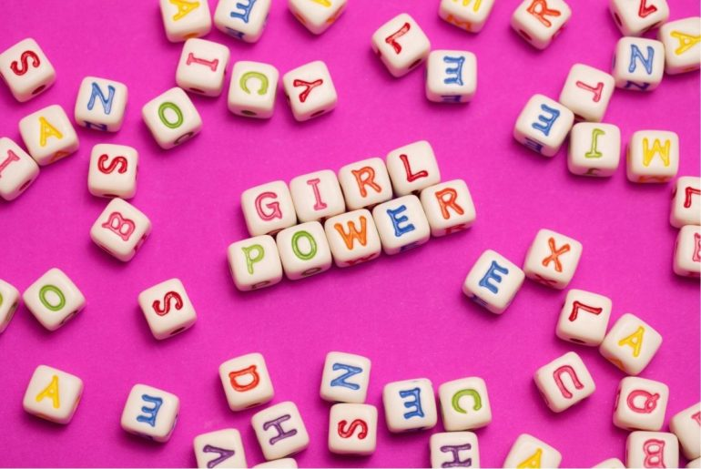 Girl power spelling in letter beads.