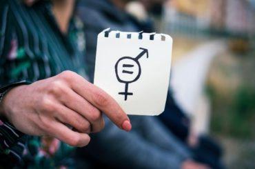 Woman holding gender equality sign.