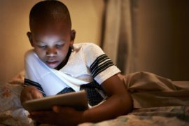 Boy using tablet.